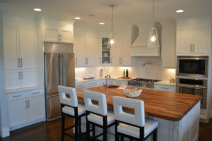 Iroko wood Island countertop with white and stools by CafeCountertops 75256