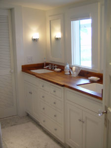 Iroko wood bathroom vanity countertop by CafeCountertops