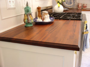 Mahogany wood countertop on white cabinets by CafeCountertops
